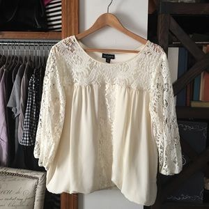 Cream lace blouse.